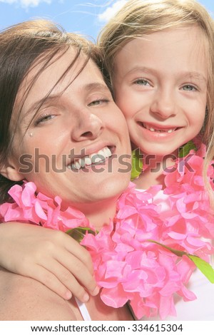 family, childhood, happiness and people - smiling mother and little girl over blue sky - stock photo