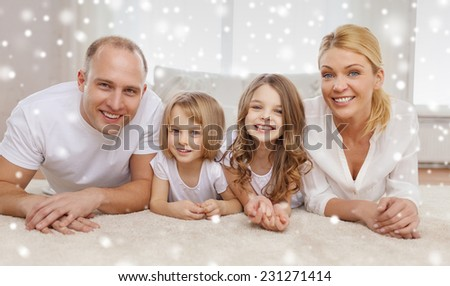 family, childhood, people and home concept - smiling parents with two little girls talking at home - stock photo