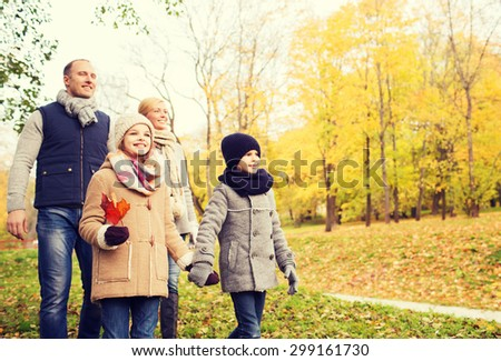 family, childhood, season and people concept - happy family in autumn park - stock photo