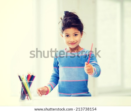 family, children and happy people concept - little girl drawing - stock photo