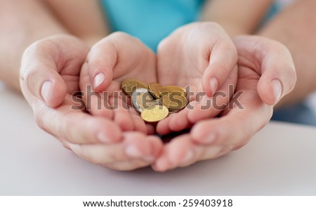 family, children, money, investments and people concept - close up of father and daughter hands holding euro money coins - stock photo