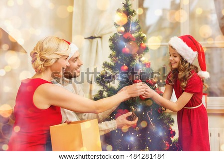 People Decorating A Christmas Tree kids decorating christmas tree stock images, royalty-free images