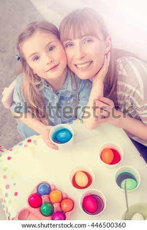 family coloring eggs at home - stock photo