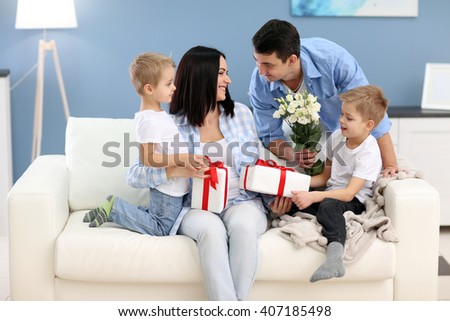 Family concept. Father with sons greeting mother, close up - stock photo