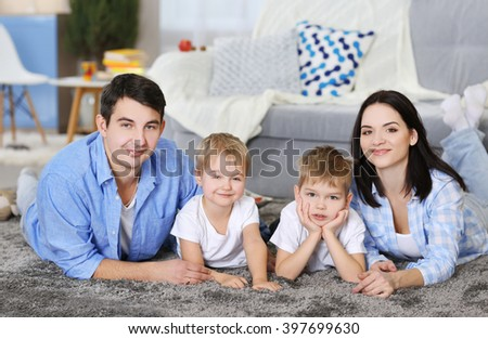 Family concept. Happy family lying on the floor in the room
