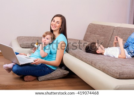 Family concept. Happy family with laptop,phone on the floor in the room.