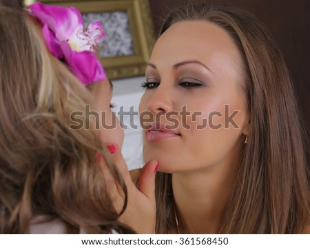 Family concept.  Mom and daughter.  Mom hugging daughter to face. She looks at her with great love. Blond - stock photo