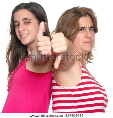 Family conflict - Teenage girl and her mother doing tumbs up, tumbs down hand gestures isolated on white - stock photo