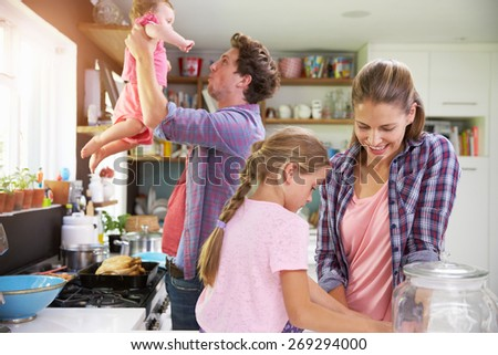 Family Cooking Meal In Kitchen Together - stock photo