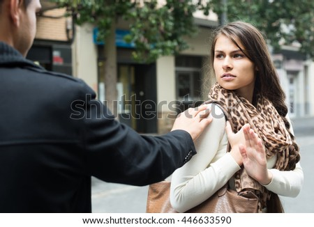 Family couple having argue on city street in autumn day - stock photo