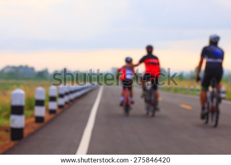 Family cycling outdoors - stock photo