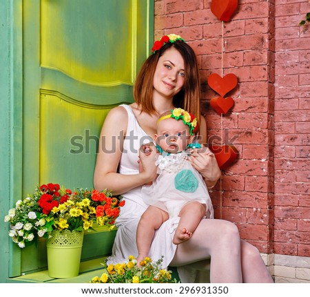 Family, daughter sitting kneeling at her mother. The concept of a happy family. - stock photo