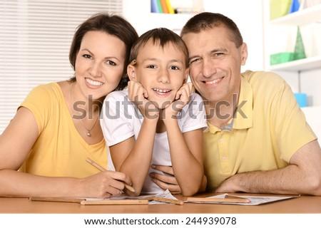 Family doing homework - stock photo