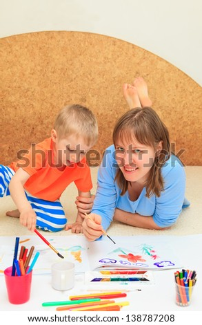family drawing together - stock photo