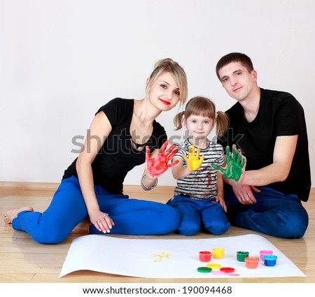family draws colored paint with your fingers - stock photo