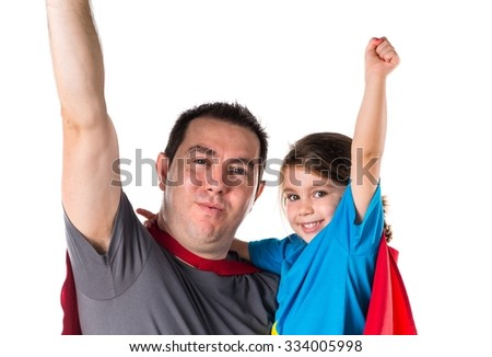 Family dressed like superhero making fly gesture - stock photo