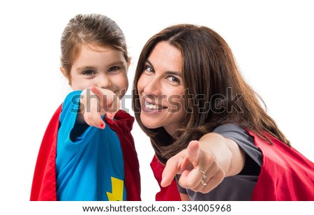 Family dressed like superhero pointing to the front - stock photo
