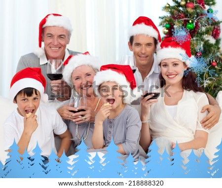 Family drinking wine and eating sweets in Christmas against snowflakes and fir trees in blue