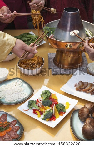 Family eating Chinese hot pot - stock photo