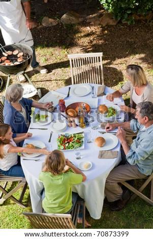 Family eating in the garden - stock photo