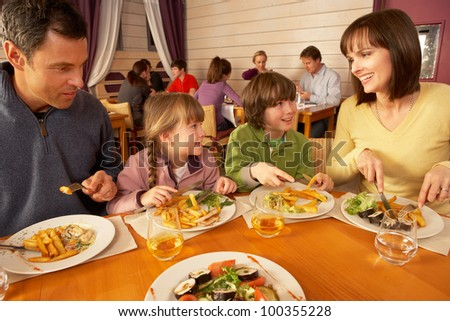 Family Eating Lunch Together In Restaurant - stock photo
