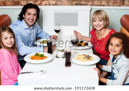Family eating lunch with their children - stock photo
