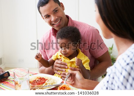 Family Eating Meal Together At Home