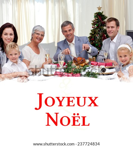 Family eating turkey in Christmas Eve Dinner against tree spiral - stock photo