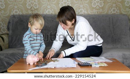 family engaged in household finances - stock photo