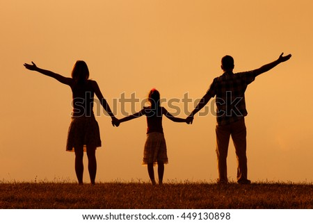 Family enjoy in sunset together.Family greeting the sunset - stock photo