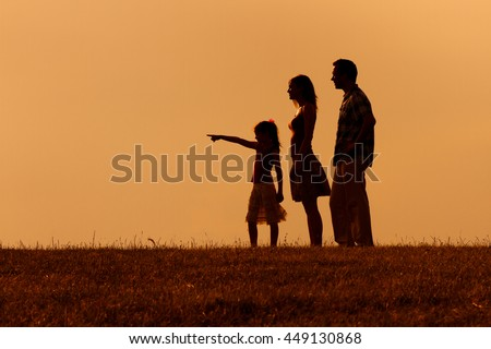 Family enjoy spending time together in nature.Precious family moments - stock photo