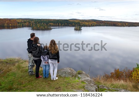 Family enjoy Swedish autumn landscape