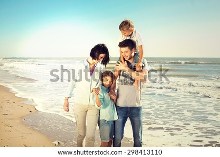 family enjoyed walking on the beach at the sea