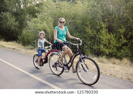 Family Enjoying a Bike Ride - stock photo