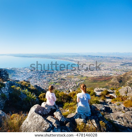 Family enjoying breathtaking views of Cape Town from top of Table mountain