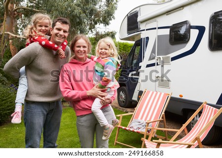 Family Enjoying Camping Holiday In Camper Van  - stock photo