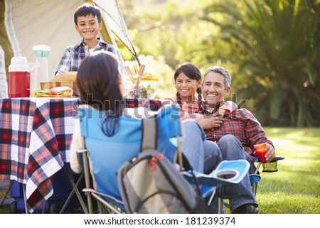 Family Enjoying Camping Holiday In Countryside - stock photo