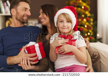 Family enjoying Christmas time at home