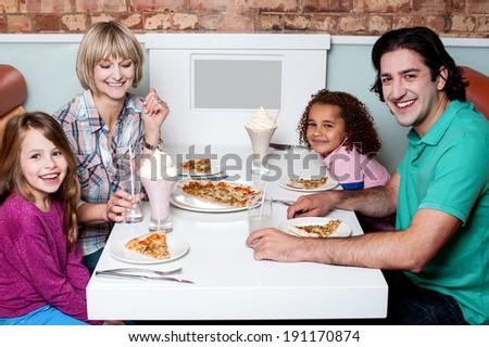 Family enjoying dinner outdoors on weekend - stock photo