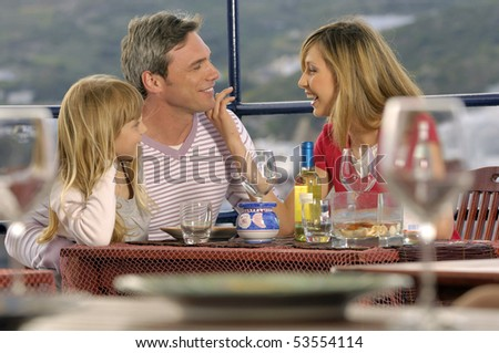 family enjoying in a restaurant - stock photo