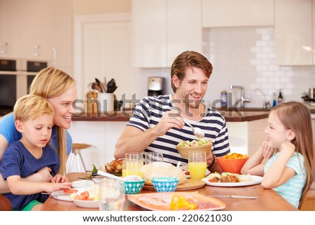 Family Enjoying Meal At Home Together - stock photo