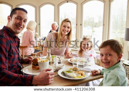 Family Enjoying Meal In Restaurant Together - stock photo