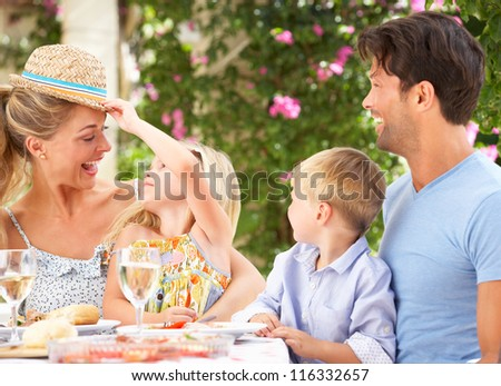 Family Enjoying Meal outdoorss