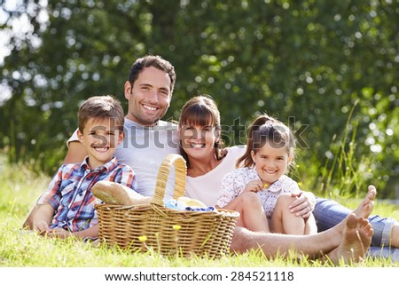 Family Enjoying Summer Picnic In Countryside - stock photo