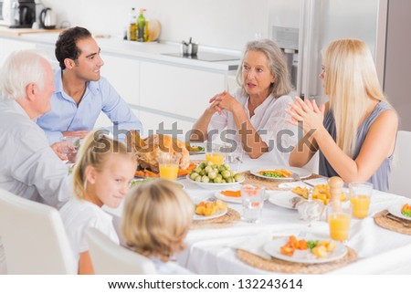 Family enjoying the thanksgiving dinner together - stock photo
