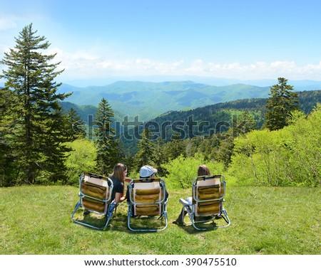 Family enjoying time on the top of mountain. North Carolina, USA. - stock photo
