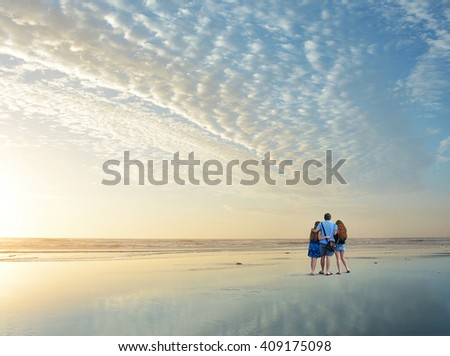Family enjoying time together on beautiful beach at sunrise., Jacksonville, Florida, USA.  - stock photo