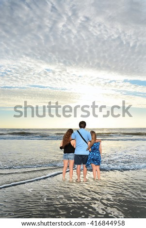 Family enjoying time together on the beach, relaxing on vacation. Jacksonville, USA, Florida. - stock photo