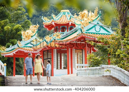 Family enjoying views of beautiful Chinese Temple on Koh Phangan island, Thailand, Asia - stock photo