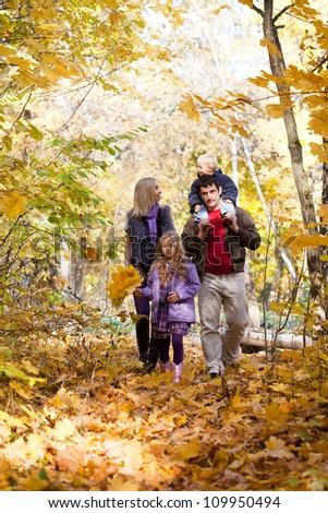 Family Enjoying Walk In Park - stock photo